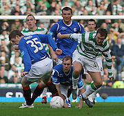 Celtic's Aiden McGeady takes on a trio of Rangers' players, left to right Steven Davis, Lee McCulloch and Steven Whittaker during the League Cup final between Rangers and Celtic at Hampden Park -<br /> David Young Universal News And Sport
