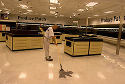 30 Sept, 2005.  New Orleans, Louisiana. Hurricane Katrina aftermath. <br /> Disaster recovery private contractors pressure wash and bleach clean the Winn Dixie supermarket in Uptown New Orleans as businesses and locals return to the city. The supermarket hopes to open on October 6th.<br /> Photo; ©Charlie Varley/varleypix.com