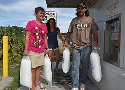 Lisa Harrelson, from left, Sheila Dennis and her husband Jimmy Dennis, all of Southport, came to Oak Island, NC, USA, on Wednesday, September 12, 2018, to find the only ice machine they could find that is still working. They all plan to stay at home during as Hurricane Florence makes its way inland. Photo by Rich Sugg/Kansas City Star/TNS/ABACAPRESS.COM