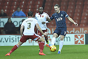 Southend United defender John White, Sheffield United defender Robert Harris during the Sky Bet League 1 match between Sheffield Utd and Southend United at Bramall Lane, Sheffield, England on 14 November 2015. Photo by Ian Lyall.