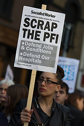 © Licensed to London News Pictures. 08/10/2013. London, UK. Protesters demonstrate outside the London Hospital in East London against the implementation of the Private Finance Initiative (PFI) debt within the Barts Health Trust group of hospitals in East London, which includes St Bartholomew's, The Royal London, Newham General, Whipps Cross and The London Chest. Photo credit : Vickie Flores/LNP