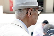 senior Asian man with hat