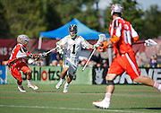 SHOT 8/16/14 4:27:19 PM - The Denver Outlaws Jeremy Noble #35 plays defense against the New York Lizards JoJo Marasco #1during their MLL Semifinals matchup at Peter Barton Lacrosse Stadium on the University of Denver campus in Denver, Co. Saturday. The Denver Outlaws won the game 14-13 to advance. (Photo by Marc Piscotty / © 2014)