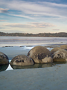 Looking over the famous Moeraki Boulders (Kaihinaki), towards the town of Moeraki, Moeraki Beach,  New Zealand.