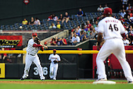 May 19 2011; Phoenix, AZ, USA; Arizona Diamondbacks second basemen Kelly Johnson (2) throws a force out to first basemen Juan Miranda (46) during the second inning against the Atlanta Braves at Chase Field. Mandatory Credit: Jennifer Stewart-US PRESSWIRE
