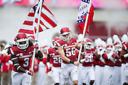 FAYETTEVILLE, AR - OCTOBER 31:  Alex Collins #3 and Matt Emrich #56 of the Arkansas Razorbacks run onto the field with flags before a game against the UT Martin Skyhawks at Razorback Stadium on October 31, 2015 in Fayetteville, Arkansas.  The Razorbacks defeated the Skyhawks 63-28.  (Photo by Wesley Hitt/Getty Images) *** Local Caption *** Alex Collins; Matt Emrich