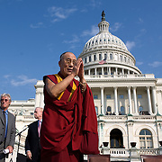 The Dalai Lama speaks before guests on the West Front of the US Capitol Wednesday, Oct. 17, 2007.   In background is actor and activist Richard Gere...Photo by Khue Bui