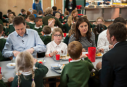 © Licensed to London News Pictures.  29/04/2015. Chippenham, Wiltshire, UK.  Deputy Prime Minister and leader of the Liberal Democrats Nick Clegg and his wife Miriam González Durántez visit a primary school in Chippenham to campaign alongside local candidate Duncan Hames.<br /> They visited Ivy Lane Primary School to meet pupils and teachers. They helped to prepare and serve lunch at the school before talking to staff about how pupils are benefiting from the Pupil Premium and capital funding to support the provision of universal free school meals.  The Liberal Democrats have set out education funding as a red line and would not enter coalition with any party that does not agree to protect per pupil funding from nursery to 19, in real terms.  Photo credit : Simon Chapman/LNP