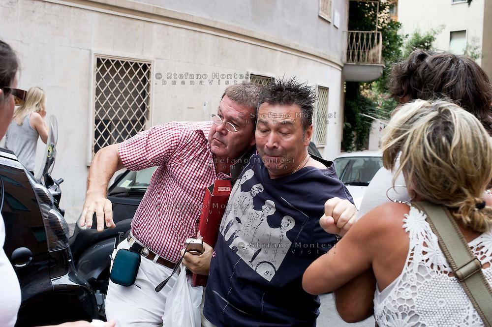 Roma 29 Luglio 2013<br /> Manifestazione di protesta ,sotto casa di Priebke, dellla 'associazione Dreyfus e   della comunit&agrave; ebraica romana ,contro i festeggiamenti   per i 100anni di Erich Priebke ex capitano delle SS condannato all'ergastolo per l'eccidio delle Fosse Ardeatine del 24 marzo 1944. Un poliziotto porta via il nipote di Priebke dopo che ha avuto uno scontro con una manifestante e ha tentato di colpirla. A quel punto &egrave; stato aggredito da alcuni manifestanti che gli hanno urlato &quot;assassino&quot;