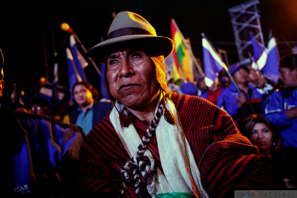 A supporter of Bolivia's President Evo Morales listens to Morales' speech during a campaign rally in El Alto, Bolivia, Thursday, Dec. 3, 2009. Morales is seeking reelection on Dec. 6 presidential elections.