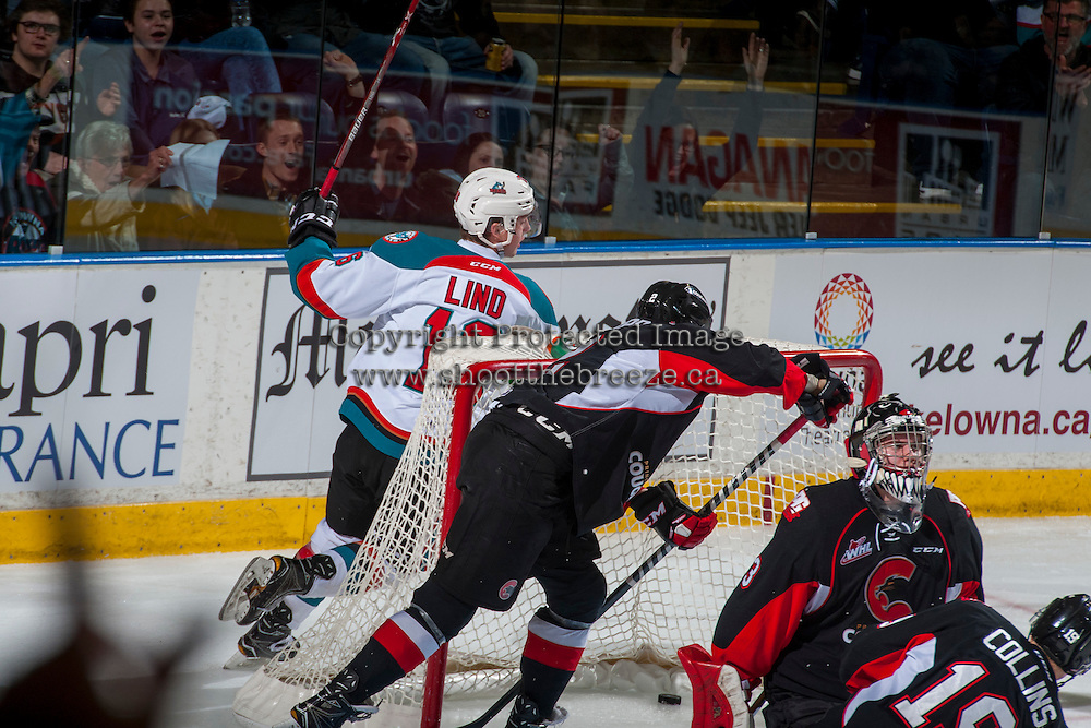KELOWNA, CANADA - FEBRUARY 18: Kole Lind #16 of the Kelowna Rockets skates behind the net after scoring a goal against Nick McBride #33 of the Prince George Cougars on February 18, 2017 at Prospera Place in Kelowna, British Columbia, Canada.  (Photo by Marissa Baecker/Shoot the Breeze)  *** Local Caption ***