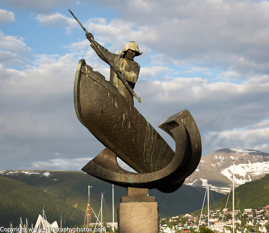 Whaling harpooning sculpture in harbour at Tromso, Norway