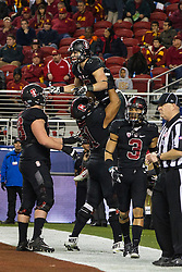 SANTA CLARA, CA - DECEMBER 05:  Running back Christian McCaffrey #5 of the Stanford Cardinal is congratulated by teammates after scoring a touchdown against the USC Trojans during the fourth quarter of the Pac-12 Championship game at Levi's Stadium on December 5, 2015 in Santa Clara, California. The Stanford Cardinal defeated the USC Trojans 41-22. (Photo by Jason O. Watson/Getty Images) *** Local Caption *** Christian McCaffrey