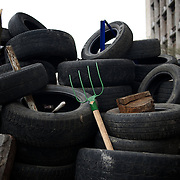 A pitchfork is seen standing in a barricade outside the Donbass Regional Government building in central Donetsk. Barricades around the building, occupied since the past weekend, have been fortified throughout the day, as the ultimatum given by the government in Kiev for the activists to abandon the building within 48 hours, is approaching its deadline.