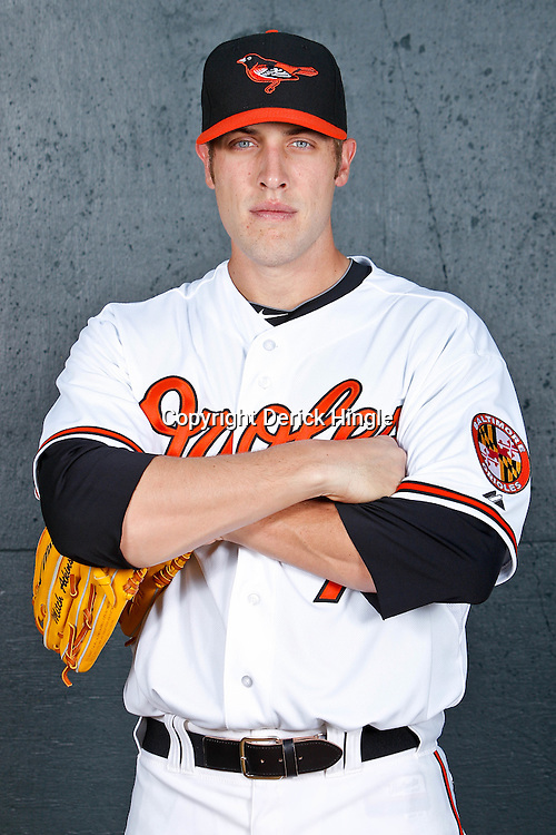 February 26, 2011; Sarasota, FL, USA; Baltimore Orioles pitcher Mitch Atkins (70) poses during photo day at Ed Smith Stadium.  Mandatory Credit: Derick E. Hingle