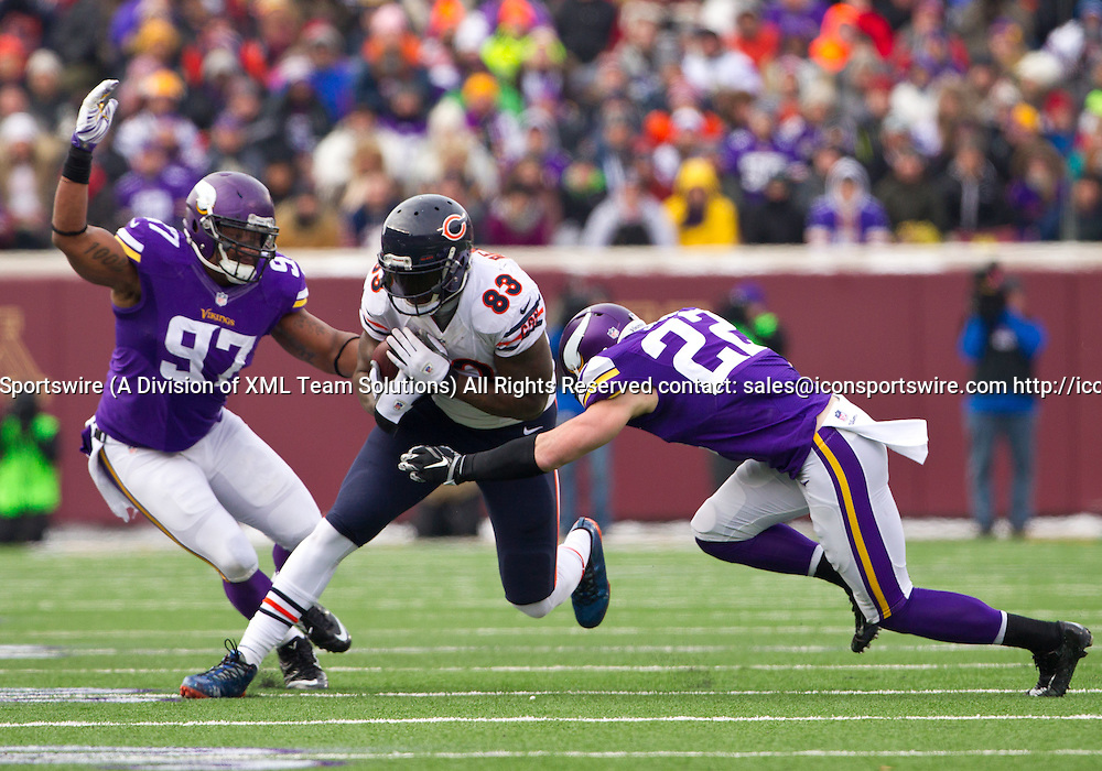 Dec 28, 2014: Minnesota Vikings Safety Harrison Smith (22) [17644] tackles Chicago Bears Tight End Martellus Bennett (83) [10385] in the 1st half. The Vikings beat the Bears 13-9 at TCF Bank Stadium in Minneapolis, MN.