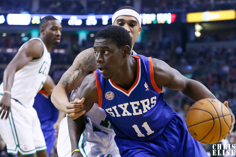 08 December 2012: Philadelphia 76ers point guard Jrue Holiday (11) drives past Boston Celtics shooting guard Courtney Lee (11) during the Boston Celtics 92-79 victory over the Philadelphia 76ers at the TD Garden, Boston, Massachusetts, USA.
