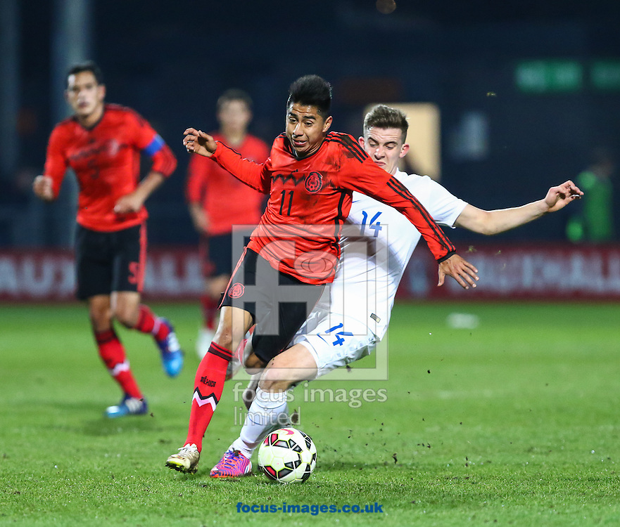 Jose David Ramirez Garcia of Mexico U20 (2nd right) is fouled by Jamie Hanson of England U20 (right) during the International Friendly match at The Hive Stadium, Harrow<br /> Picture by David Horn/Focus Images Ltd +44 7545 970036<br /> 25/03/2015