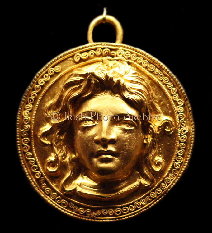Gold shield-shaped pendant with female head, possibly Medusa 200-150 BC