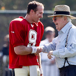 July 29, 2012; Metairie, LA, USA; New Orleans Saints quarterback Drew Brees (9) talks with owner Tom Benson during a training camp practice at the team's practice facility. Mandatory Credit: Derick E. Hingle-US PRESSWIRE