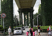 SHANGHAI, CHINA - JULY 22: (CHINA OUT) <br /> <br /> Green Plants Cover Columns Along Shanghai's Subway Station<br /> and turns it in to a small primitive forest. <br /> <br /> Green plants cover on the columns along viaduct of Shanghai Caoxi Road Subway Station on July 22, 2015 in Shanghai, China. It seems that the lush green plants make a small primitive forest. <br /> ©Exclusivepix Media