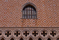 Window and geometric facade of the Doges Palace in Venice, Italy.