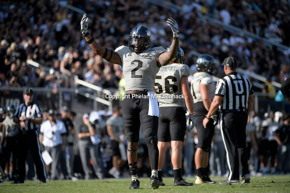 Central Florida linebacker Chequan Burkett (2) encourages fans in the stands during the second half of the American Athletic Conference championship NCAA college football game against Memphis Saturday, Dec. 2, 2017, in Orlando, Fla. Central Florida won 62-55. (Photo by Phelan M. Ebenhack)
