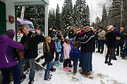 "The Yaak K-8 grade School prepares to sing ""This Land is Your Land"" before the presentation for the cutting of the Capitol Christmas tree that was selected in the Yaak Valley at the Historic Upper Ford Ranger Station. Kootenai National Forest in the Purcell Mountains, northwest Montana."