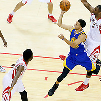25 May 2015: Golden State Warriors guard Stephen Curry (30) goes for the jump shot past Houston Rockets forward Terrence Jones (6) during the Houston Rockets 128-115 victory over the Golden State Warriors, in game 4 of the Western Conference finals, at the Toyota Center, Houston, Texas, USA.