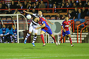 Aldershot Town's Will Evans(5) beats Forest Green Rovers Rhys Murphy(39) to the ball during the Vanarama National League match between Aldershot Town and Forest Green Rovers at the EBB Stadium, Aldershot, England on 4 October 2016. Photo by Shane Healey.
