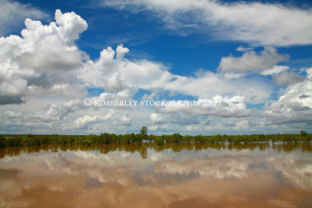 Clouds reflected in the still water after a west Kimberley wet season storm near Willare.