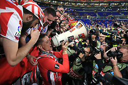 Atletico Madrid's Fernando Torres celebrates with a megaphone after winning the UEFA Europa League final at Parc Olympique Lyonnais, Lyon.