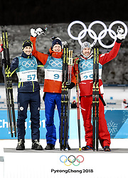 PYEONGCHANG-GUN, SOUTH KOREA - FEBRUARY 15: Gold medallist Johannes Thingnes Boe (C) of Norway celebrates with silver medallist Jakov Fak (L) of Slovenia and bronze medallist Dominik Landertinger of Austria during the victory ceremony for the Men's 20km Individual Biathlon at Alpensia Biathlon Centre on February 15, 2018 in Pyeongchang-gun, South Korea. Photo by Chine Nouvelle/SIPA