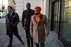 © Licensed to London News Pictures. 18/01/2017. London, UK. Conservative Party donor and Businessman PETER SINGH VIRDEE (right), flanked by security guards as he arrives at Westminster Magistrates Court in London where he faces extradition to Germany. Mr Virdee, who was arrested at Heathrow airport, is accused by German prosecutors of being part of a criminal enterprise to defraud the authorities of €125m (£109m) of VAT on carbon credits under the EU Emissions Trading Scheme. Photo credit: Ben Cawthra/LNP