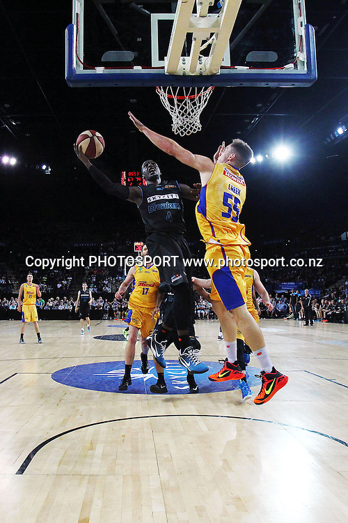 Cedric Jackson of the Breakers takes on Mitch Creek of the 36ers. 2014/15 ANBL, SkyCity Breakers vs Adelaide 36ers, Vector Arena, Auckland, New Zealand. Thursday 12 February 2015. Photo: Anthony Au-Yeung / www.photosport.co.nz
