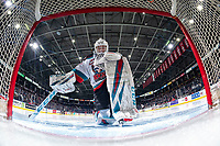 KELOWNA, BC - FEBRUARY 7: Cole Schwebius #31 of the Kelowna Rockets kneels in net for prayer at the start of second period against the Portland Winterhawks at Prospera Place on February 7, 2020 in Kelowna, Canada. (Photo by Marissa Baecker/Shoot the Breeze)