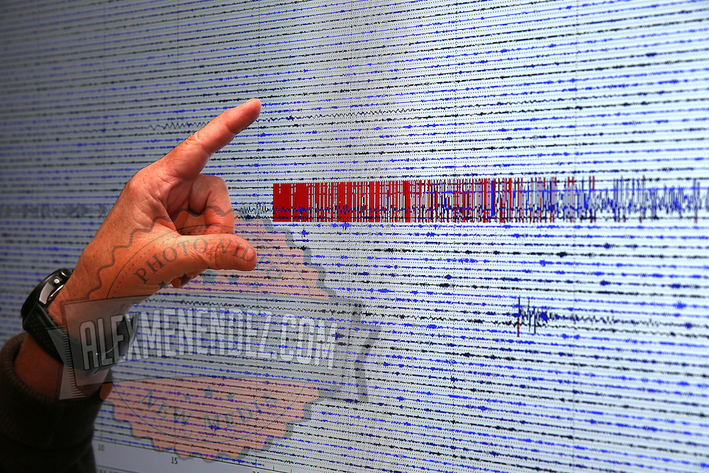Doctor Peggy Hellweg, a geophysicist at the Berkeley Seismological Laboratory shows the magnitude on the seismograph of the Napa earthquake as seen from a recording station located in Berkeley, California, on Monday, August 24, 2014.  On Sunday, a 6.1 magnitude earthquake caused significant damage and left three critically injured in California's northern Bay Area early Sunday, igniting fires, sending at least 87 people to a hospital, knocking out power to tens of thousands and sending residents running out of their homes in the darkness. Aftershocks are still being captured across the area by seismometers that are recording seismic data. (AP Photo/Alex Menendez)
