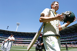 © Licensed to London News Pictures. 29/12/2013. Australian captain Michael Clarke walks off the field after Australia won the 4th test during Day 4 of the Ashes Boxing Day Test Match between Australia Vs England at the MCG on 29 December, 2013 in Melbourne, Australia. Photo credit : Asanka Brendon Ratnayake/LNP