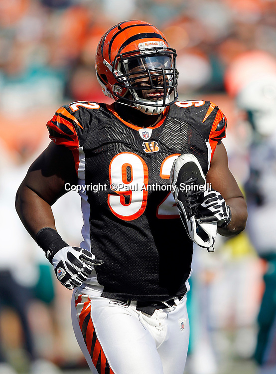 Cincinnati Bengals defensive end Frostee Rucker (92) jogs off the field while holding his shoe during the NFL week 8 football game against the Miami Dolphins on Sunday, October 31, 2010 in Cincinnati, Ohio. The Dolphins won the game 22-14. (©Paul Anthony Spinelli)