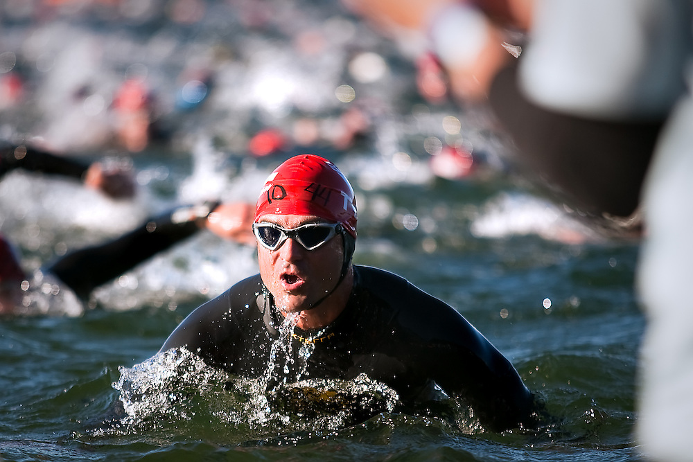 Chris Onufer of Tetonia, Idaho takes a deep breath coming out of the water during a quick warm-up swim before the 2010 Ironman competition in Coeur d'Alene on Sunday...