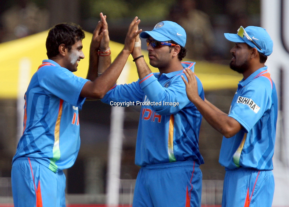 Indian bowler Ravichandran Ashwin Celebrates with Yuvraj Singh New Zealand batsman Scott Styris wicket during the 3rd ODI India vs New Zealand Played at Reliance Stadium, Vadodara, 4 December 2010 (50-over match)