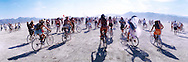 "Bikers begin a group bike tour around the desert during the16th annual Burning Man festival, August 29, 2001 in the Black Rock Desert near Gerlach, Nevada.An estimated record 29,000 people camped out on a remote desert playa, or dry lake, for the week-long counter-cultural celebration of art and ""radical self-expression."" This year's theme was thethe stages of man."