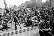 Man in leather jacket standing on van, Reclaim the Streets, Trafalgar Square, London, May 1997