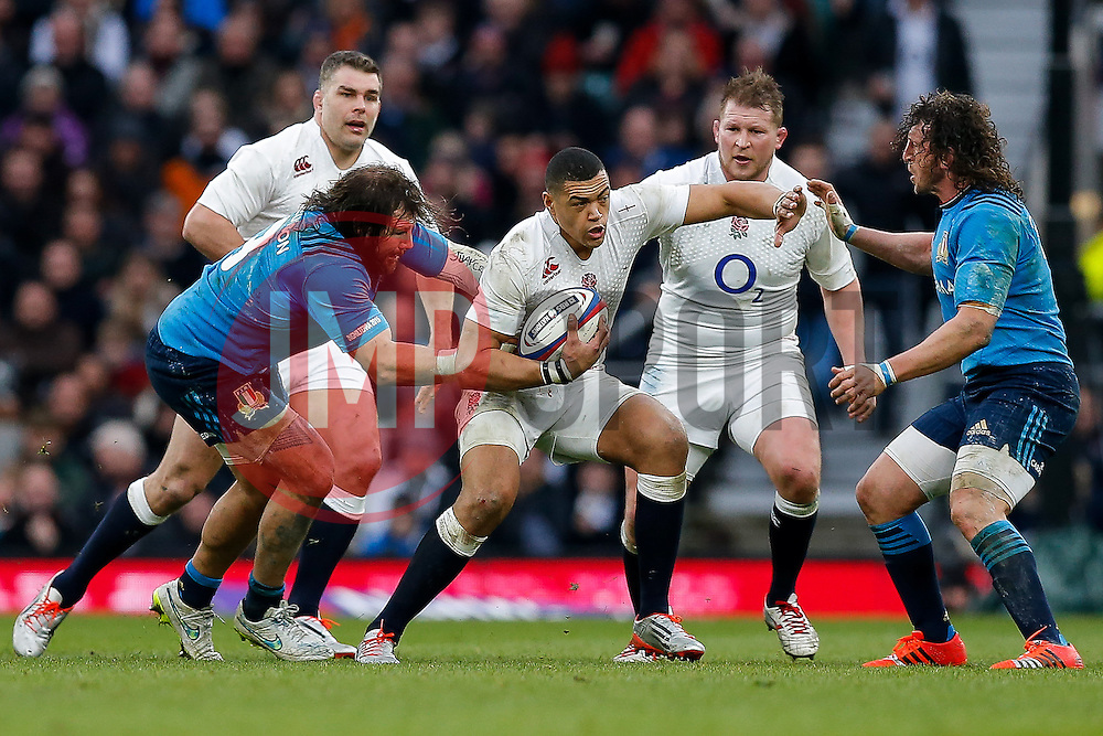 England Inside Centre Luther Burrell is tackled by Italy Prop Martin Castrogiovanni - Photo mandatory by-line: Rogan Thomson/JMP - 07966 386802 - 14/02/2015 - SPORT - RUGBY UNION - London, England - Twickenham Stadium - England v Italy - 2015 RBS Six Nations Championship.