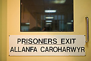 The prisoner exit sign from the visits room, in English and Welsh.