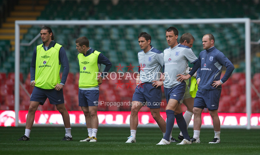 CARDIFF, WALES - Friday, March 25, 2011: England's Andy Carroll, Jack Wilshere, Frank Lampard, captain John Terry and Wayne Rooney during a training session at the Millennium Stadium ahead of the UEFA Euro 2012 qualifying Group G match against England. (Photo by David Rawcliffe/Propaganda)