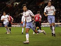 Photo: Paul Thomas.<br /> Sheffield United v Aston Villa. The Barclays Premiership. 11/12/2006.<br /> <br /> Milan Baros (10) celebrates his goal for Villa with Gavin McCann (8).
