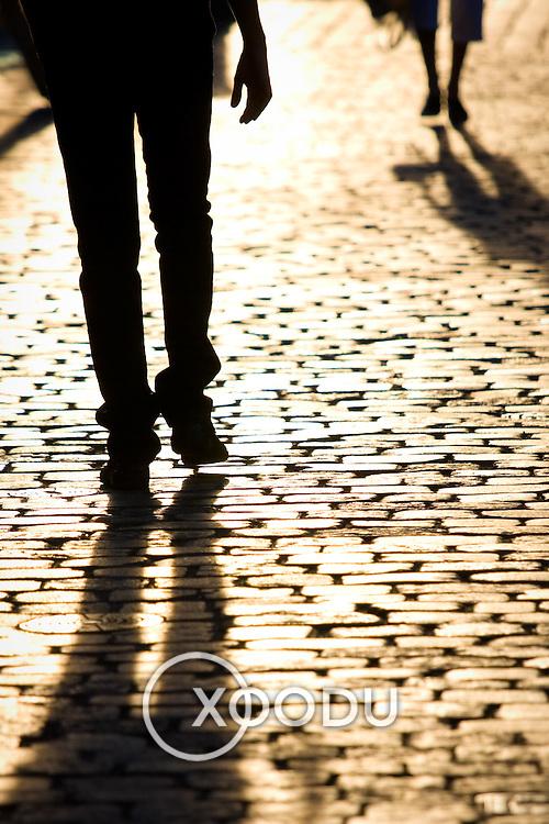 Pedestrian silhouette shadows on cobblestones (Wroclaw, Poland - Aug. 2008) (Image ID: 080806-1924431a)