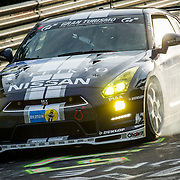 #123 Team GT Academy GT-R with left front tire problem with smoke  during the 24 Hours of Nurburgring.