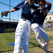 Shane Carrier (4) and teammate Justin Row of the Fullerton Hornets practice their celebration routine before the start of their game on Saturday, November 7, 2015 in Fullerton, California. <br /> <br /> Mandatory Copyright Notice: Copyright 2015 (Photo by Sarah Sachs) Mandatory Copyright Notice: Copyright 2015 (Photo by Sarah Sachs)
